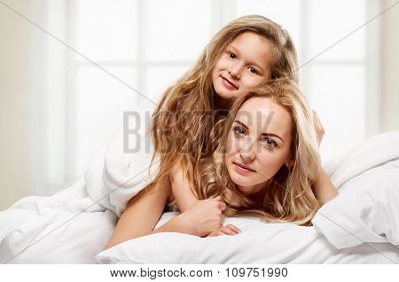 Happy family. Mother and little daughter portrait