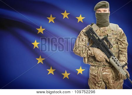 Soldier Holding Machine Gun With Flag On Background Series - European Union - Eu