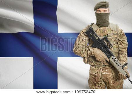 Soldier Holding Machine Gun With Flag On Background Series - Finland