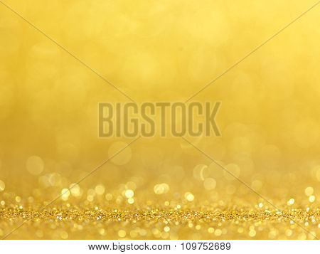 gold abstract bokeh lights. defocused background