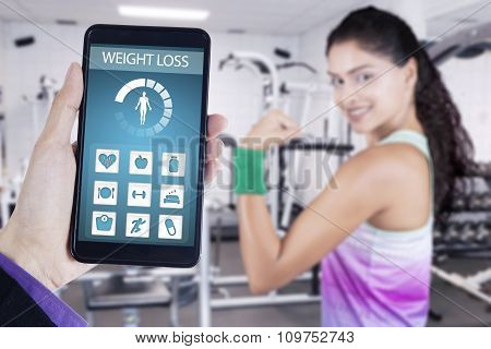Weight Loss App And Healthy Woman Shows Bicep