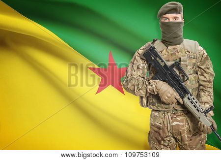 Soldier Holding Machine Gun With Flag On Background Series - French Guiana