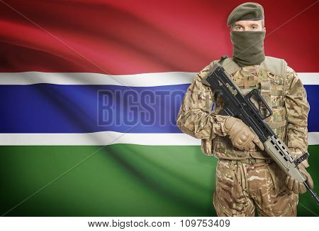 Soldier Holding Machine Gun With Flag On Background Series - Gambia