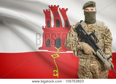Soldier Holding Machine Gun With Flag On Background Series - Gibraltar