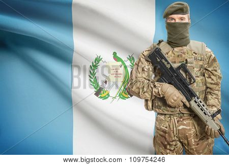 Soldier Holding Machine Gun With Flag On Background Series - Guatemala
