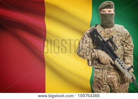 Soldier Holding Machine Gun With Flag On Background Series - Guinea