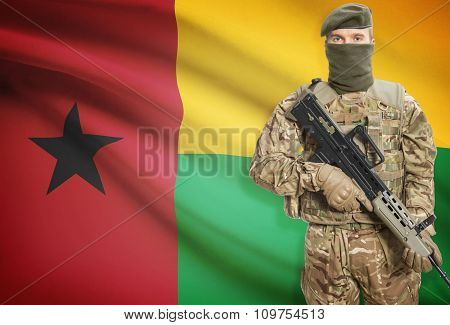 Soldier Holding Machine Gun With Flag On Background Series - Guinea-bissau