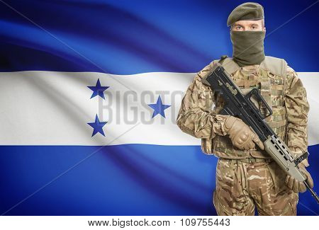 Soldier Holding Machine Gun With Flag On Background Series - Honduras