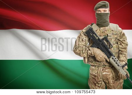 Soldier Holding Machine Gun With Flag On Background Series - Hungary