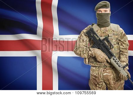 Soldier Holding Machine Gun With Flag On Background Series - Iceland