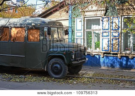 Irkutsk, Russia-Oct 04,2015:Old Soviet Bus Kavz 685 On The Street Near The Wooden House With Carving