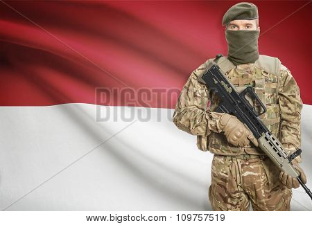 Soldier Holding Machine Gun With Flag On Background Series - Indonesia