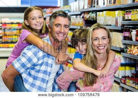 Portrait of happy family at the supermarket