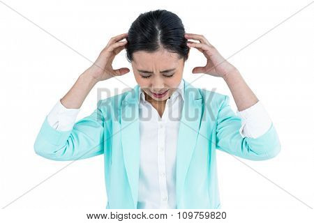 Worried businesswoman holding her head against white background