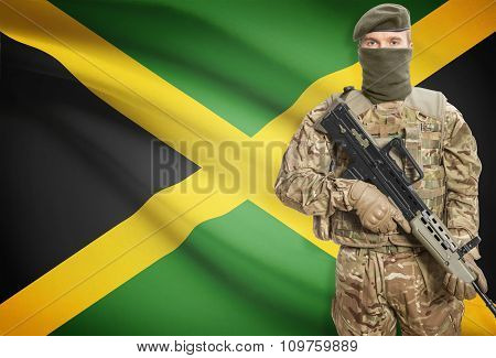 Soldier Holding Machine Gun With Flag On Background Series - Jamaica