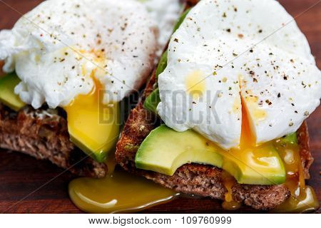 Delicious Egg with Whole Grain grilled Bread and Sliced Avocado