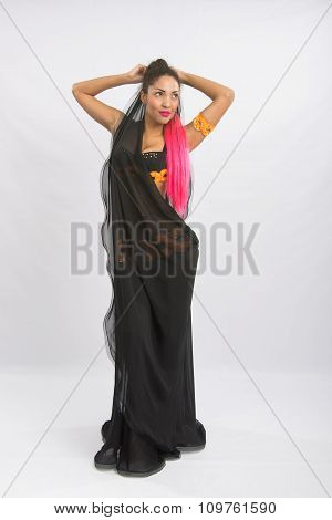 Young Girl Mulatto Dancing In A Long Black Dress Candid