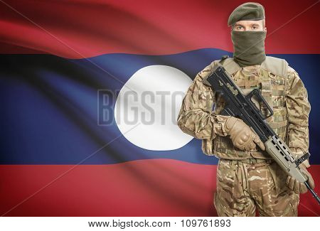 Soldier Holding Machine Gun With Flag On Background Series - Laos