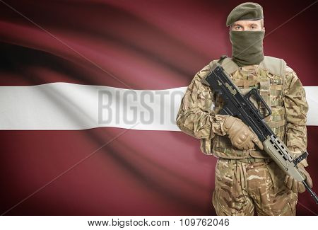 Soldier Holding Machine Gun With Flag On Background Series - Latvia