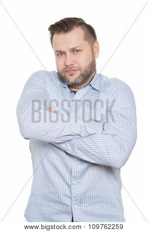 adult male with a beard. isolated on white background. crossing arms. clenched fists. gesture of dis