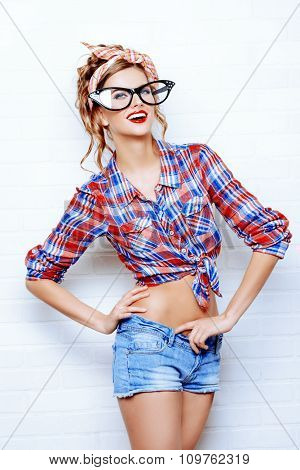 Close-up portrait of a funny glamorous pin-up girl in a huge stylish glasses. Beauty, fashion. Optics, eyewear.