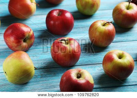Fresh Apples On A Blue Wooden Table