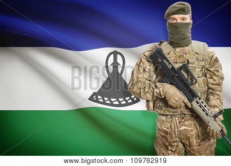Soldier Holding Machine Gun With Flag On Background Series - Lesotho