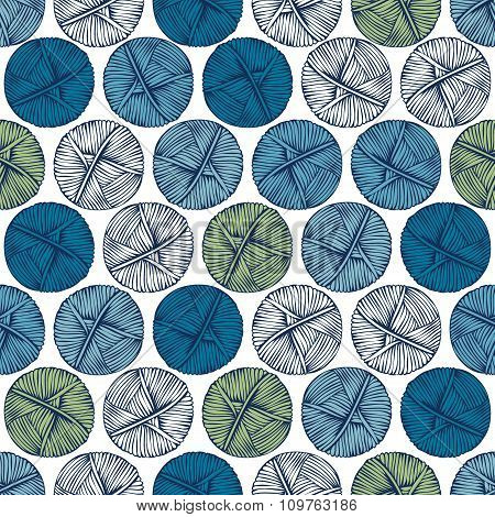 Blue And Green Balls Of Yarn On A Light Background.
