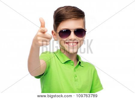 childhood, fashion, accessory, style and people concept - happy smiling boy in sunglasses and green polo t-shirt