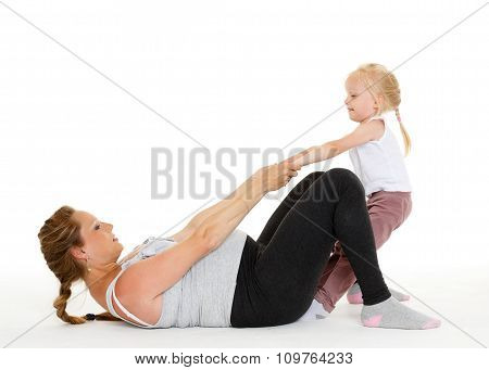 Pregnant Woman With Daughter. Fitness.