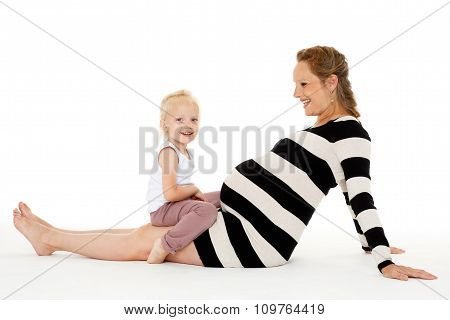 Happy Pregnant Woman With Daughter.