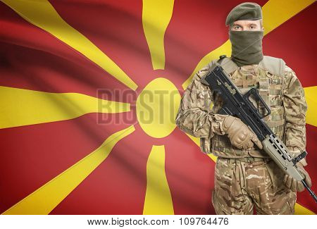 Soldier Holding Machine Gun With Flag On Background Series - Macedonia