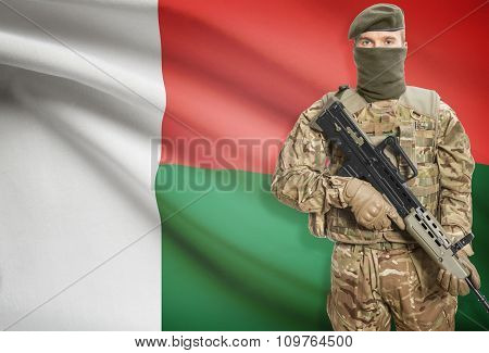 Soldier Holding Machine Gun With Flag On Background Series - Madagascar