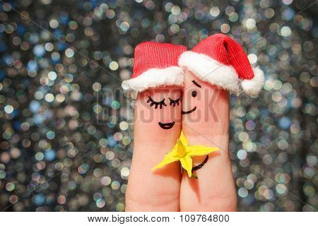 Finger art of a Happy couple celebrates Christmas. Man is giving flowers to a woman.