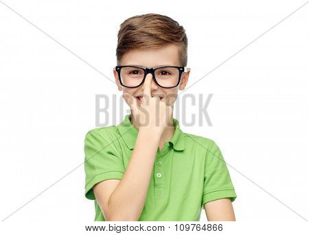 childhood, vision, school, education and people concept - happy smiling boy in green polo t-shirt in eyeglasses