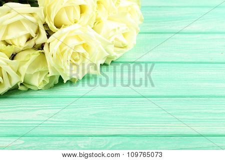 Bouquet Of White Roses On A Mint Wooden Table