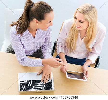 Two female business colleagues, high angle view