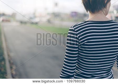 Ordinary Woman Walking Down The Street