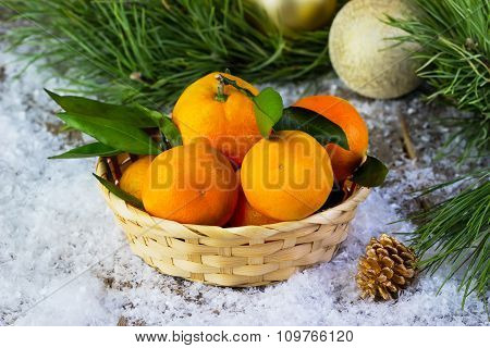 Tangerines In A Plate On A Snow-covered Background