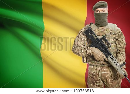Soldier Holding Machine Gun With Flag On Background Series - Mali
