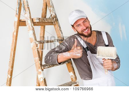 Painter In White Dungarees With Thumbs Up Gesture