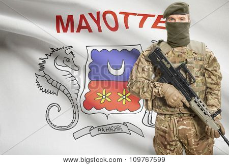 Soldier Holding Machine Gun With Flag On Background Series - Mayotte