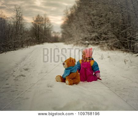 Little Girl And Teddy Bear Playing Outdoor