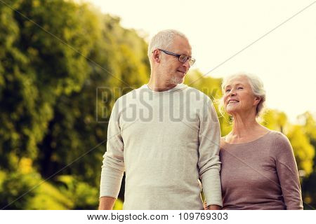family, age, tourism, travel and people concept - senior couple in park