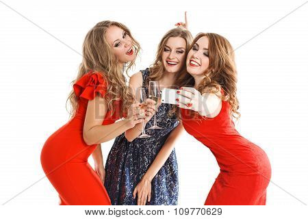 girlfriends do smartphone selfi isolated on white background in beautiful dresses