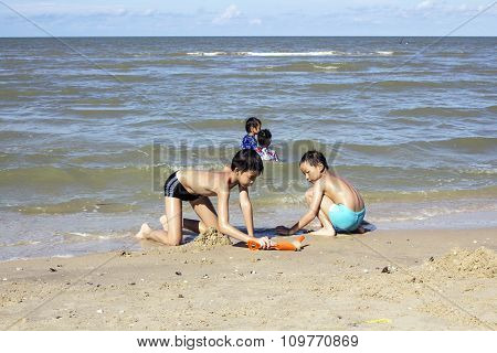 Children Playing With Beach Toys Under Sunlight