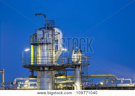 Distillation Tower At Night