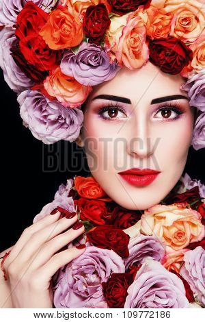 Young beautiful woman in fancy vintage wig and necklace of colorful roses