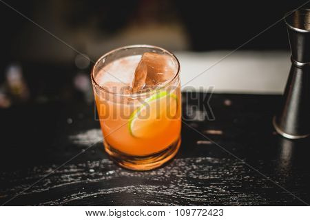 Orange Cocktail Decorated With Lime Slice