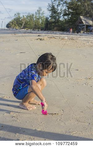 Asian Thai Little Boy Playing Sand